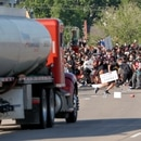A tanker truck drives into thousands of protesters marching on 35W north bound highway during a protest against the death in Minneapolis police custody of George Floyd, in Minneapolis, Minnesota, U.S. May 31, 2020. REUTERS/Eric Miller