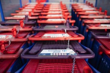 Shopping carts outside a Carrefour SA hypermarket in Avignon, France, on Friday, Jan. 15, 2021. Alimentation Couche-Tard Inc. plans to pump 3 billion euros ($3.6 billion) into Carrefour as the Canadian convenience-store operator seeks to defuse mounting French political concerns over the proposed $20 billion takeover of the French retailer.