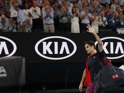 Tennis - Australian Open - Semi Final - Melbourne Park, Melbourne, Australia - January 30, 2020. Switzerland's Roger Federer waves as he leaves after his match against Serbia's Novak Djokovic. REUTERS/Issei Kato