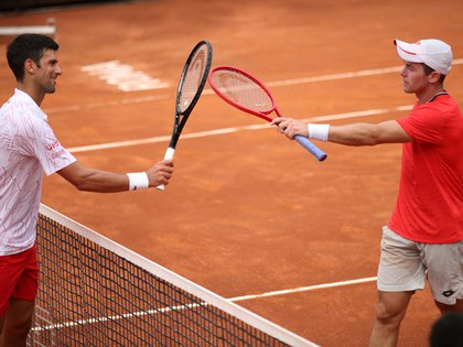 Tennis - ATP Masters 1000 - Italian Open - Foro Italico, Rome, Italy - September 19, 2020  Serbia's Novak Djokovic with Germany's Dominik Koepfer after winning their quarter final match  Pool via REUTERS/Clive Brunskill