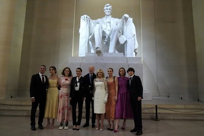 """United States President Joe Biden and United States First Lady Jill Biden pose with their family in front of the Abraham Lincoln statue at the event """"Celebrating America"""" at the Lincoln Memorial after the inauguration of Joe Biden as the 46th President of the United States in Washington"""