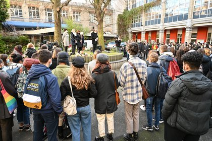 Students and educational staff gather in the courtyard of Lycee Fenelon's school in Lille on December 18, 2020 to pay tribute to a transgender student two days after she committed suicide.  DENIS CHARLET / AFP