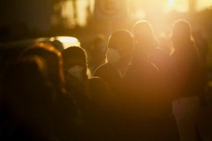 Teachers and school staff queue to receive a dose of the CanSino coronavirus disease (COVID-19) vaccine, during a mass vaccination program at the Autonomous University of Coahuila, in Arteaga, Mexico April 20, 2021. REUTERS/Daniel Becerril