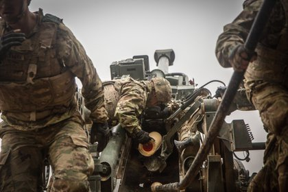 December 2, 2018 - Iraq: A U.S. Army Soldier assigned to the 3rd Cavalry Regiment loads propellant into the M777 Howitzer during a fire mission in Southwest Asia. 3rd Cav. Regt. is part of Combined Joint Task Force - Operation Inherent Resolve, supporting the Syrian Democratic Forces as they clear the last remaining pockets of ISIS from the Middle Euphrates River Valley and prevent them from fleeing into Iraq. In conjunction with partner forces, Combined Joint Task Force - Operation Inherent Resolve defeats ISIS in designated areas of Iraq and Syria and sets conditions for follow-on operations to increase regional stability. (Mikki L. Sprenkle/US Army/Polaris)