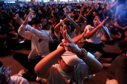 People gesture during anti-government protests, in Bangkok, Thailand October 15, 2020. REUTERS/Soe Zeya Tun