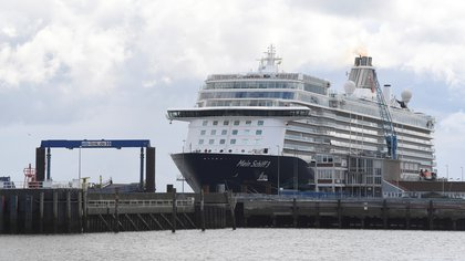 "Cruise ship ""Mein Schiff 3"" sits in the harbour with nearly 3000 travel agency TUI staff members quarantined onboard, according to local media, during the coronavirus disease (COVID-19) spread, in Cuxhaven, Germany May 2, 2020. REUTERS/Fabian Bimmer"