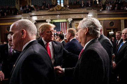 February 5, 2019 - Washington, DC, United States: President Trump shook hands with Senator Mitch McConnell, R-KY, after the State of the Union at the Capitol. (Polaris)