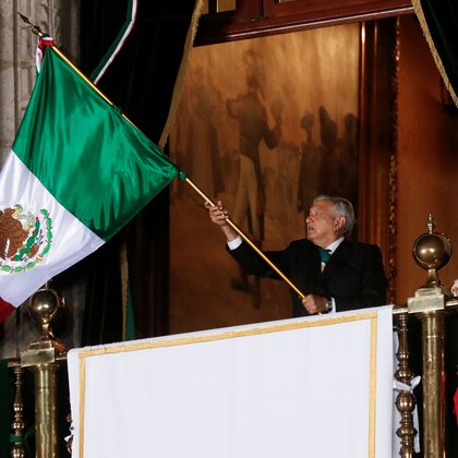 "Mexico's President Andres Manuel Lopez Obrador waves the national flag after shouting the ""Cry of Independence"" as Mexico marks its 210th anniversary of independence from Spain, at the National Palace in Mexico City, Mexico, September 15, 2020. REUTERS/Henry Romero"