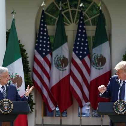 U.S. President Donald Trump listens to Mexico's President Andres Manuel Lopez Obrado as the leaders deliver individual statements prior to signing a joint declaration in the Rose Garden at the White House in Washington, U.S., July 8, 2020. REUTERS/Kevin Lamarque