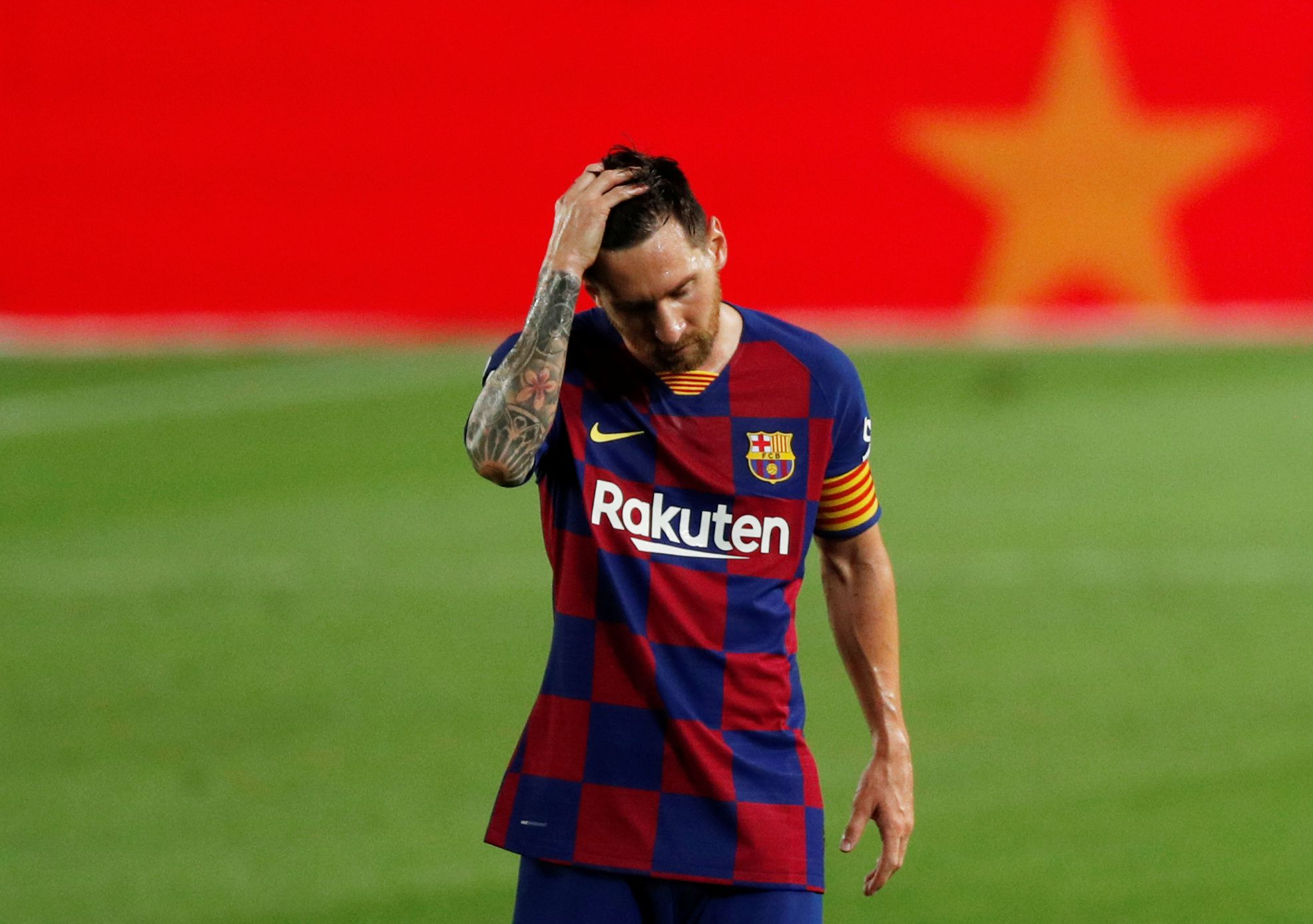 Soccer Football - La Liga Santander - FC Barcelona v Osasuna - Camp Nou, Barcelona, Spain - July 16, 2020   Barcelona's Lionel Messi looks dejected after the match, as play resumes behind closed doors following the outbreak of the coronavirus disease (COVID-19)   REUTERS/Albert Gea