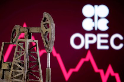 FILE PHOTO: A 3D printed oil pump jack is seen in front of displayed stock graph and Opec logo in this illustration picture, April 14, 2020. REUTERS/Dado Ruvic
