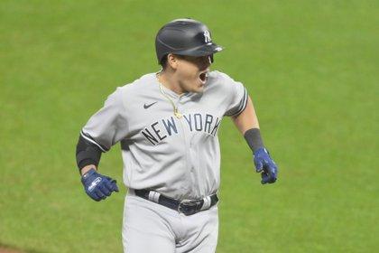 Sep 30, 2020; Cleveland, Ohio, USA; New York Yankees third baseman Gio Urshela (29) celebrates his grand slam in the fourth inning against the Cleveland Indians at Progressive Field. Mandatory Credit: David Richard-USA TODAY Sports