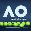 FILE PHOTO: Tennis - Australian Open - Melbourne, Australia, January 14, 2018. Tennis balls are pictured in front of the Australian Open logo before the tennis tournament. REUTERS/Thomas Peter/File Photo