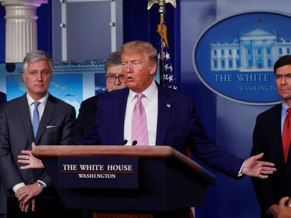 U.S. President Donald Trump addresses the daily coronavirus response briefing flanked by National Security Advisor Robert O'Brien, U.S. Attorney General Bill Barr and U.S. Defense Secretary Mark Esper at the White House in Washington, U.S., April 1, 2020. REUTERS/Tom Brenner