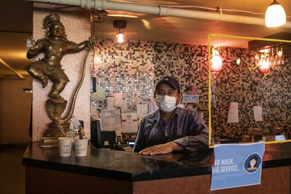 Manjit Singh, 45, at his restaurant, Jackson Diner, in Queens on Feb. 19, 2021. Singh says he struggled to find the time to secure a vaccination appointment, but with the help of volunteers, he recently scheduled an appointment in March. (Kirsten Luce/The New York Times)