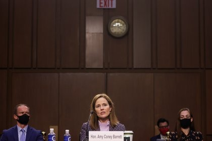 U.S. Supreme Court nominee Judge Amy Coney Barrett testifies on the third day of her U.S. Senate Judiciary Committee confirmation hearing as her husband, Jesse, listens on Capitol Hill in Washington, U.S., October 14, 2020. REUTERS/Jonathan Ernst/Pool
