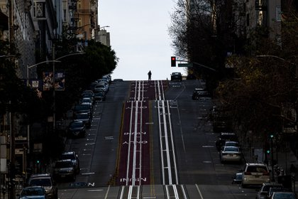 A street in San Francisco with almost no people, during the order to stay in their homes that was in effect for the last month.