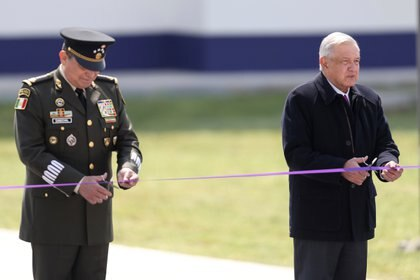 Mexican President Andres Manuel Lopez Obrador and Secretary of Defense Luis Sandoval cut a ribbon during the inauguration of the first stage of the new international airport in Zumpango de Ocampo, at the Santa Lucia military airbase on the outskirts of Mexico City, Mexico February 10, 2021. REUTERS/Edgard Garrido