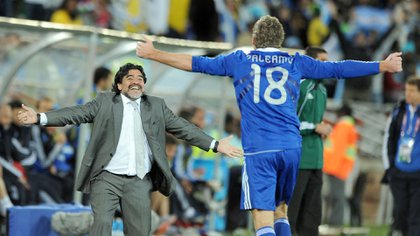 EDITORIAL USE ONLYMandatory Credit: Photo by Back Page Images/Shutterstock (1199187a)Martin Palermo of Argentine celebrates scoring his side's second goal with manager Diego MaradonaGreece v Argentina, 2010 FIFA World Cup football match, Polokwane, South Africa - 22 Jun 2010