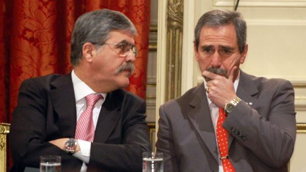 Julio De Vido y Ricardo Jaime, dos de los ex funcionarios con más causas penales por corrupción en trámite ante laa Justicia. (NA)