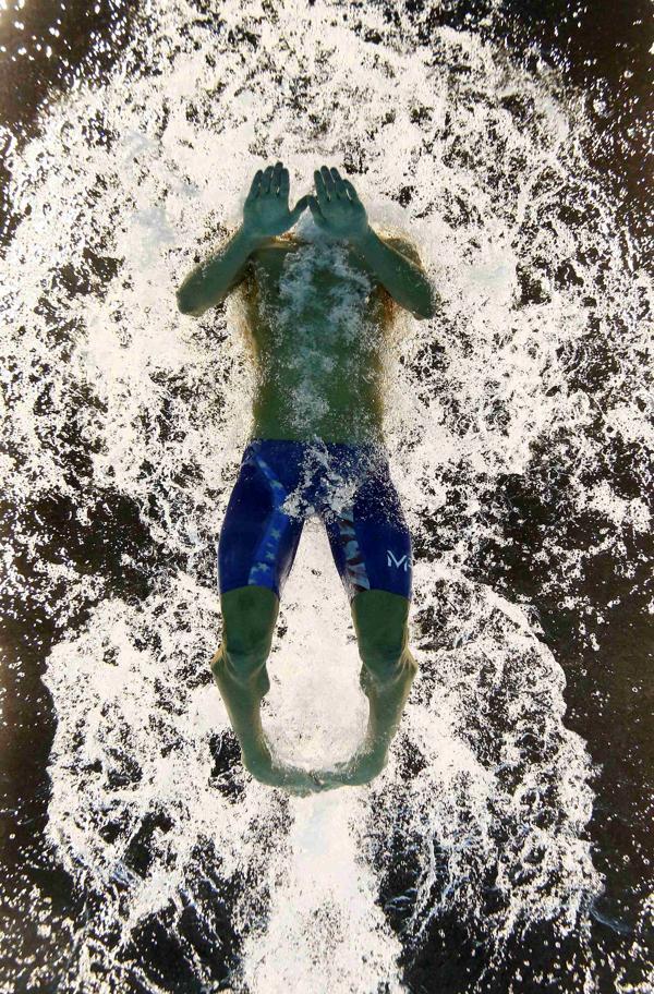 """Bob Bowman fue el primer profesor de Phelps, a los 11 años, y quien lo guió en sus primeros pasos como nadador. Fue, además, el padre """"elegido"""" por el Tiburón de Baltimore debido a la mala relación que tuvo con su progenitor (Reuters)"""