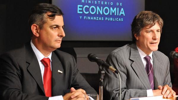 AmadoBoudou y Daniel Reposo, quien encabezaba la SIGEN en 2009 (Foto de archivo – NA)